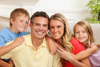 Young smiling family happy with Brown's Heating and Air Conditioning