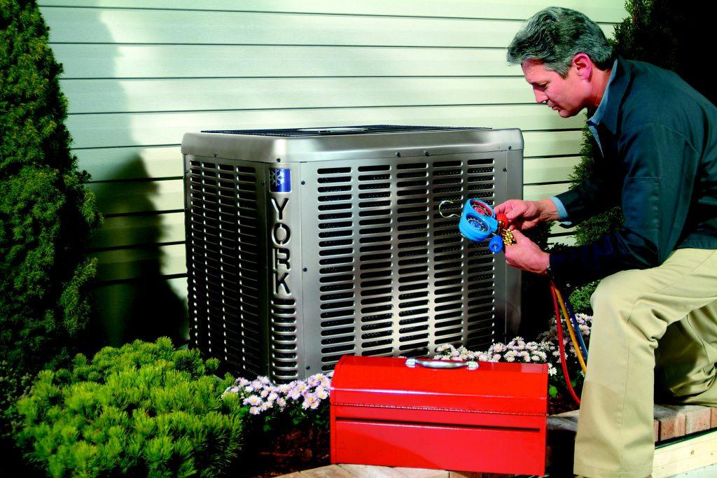 Technician check refrigerant on air conditioner